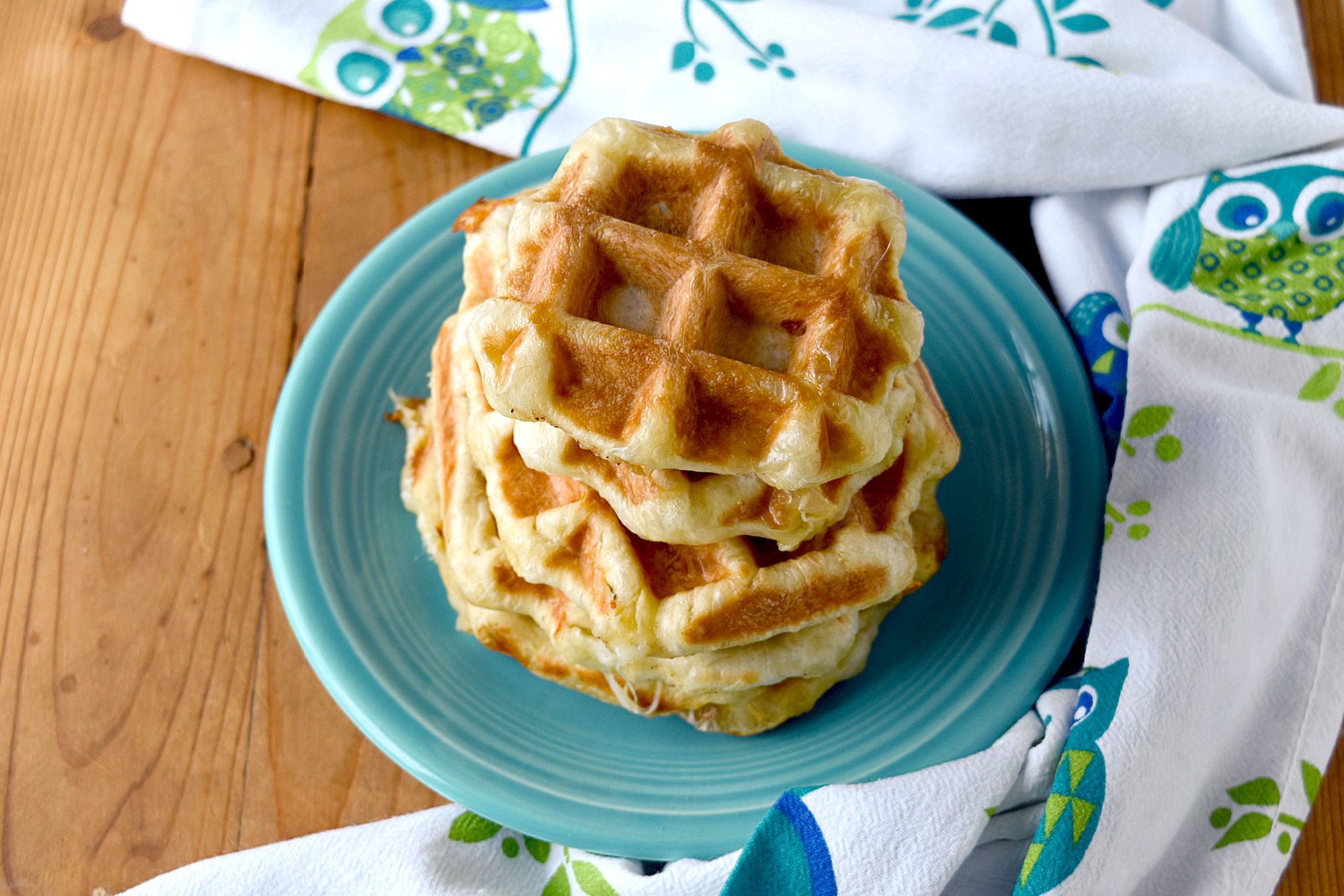 Cheesy Garlic Butter Waffles have only three ingredients. They're easy to make and taste so delicious! #OurFamilyTable