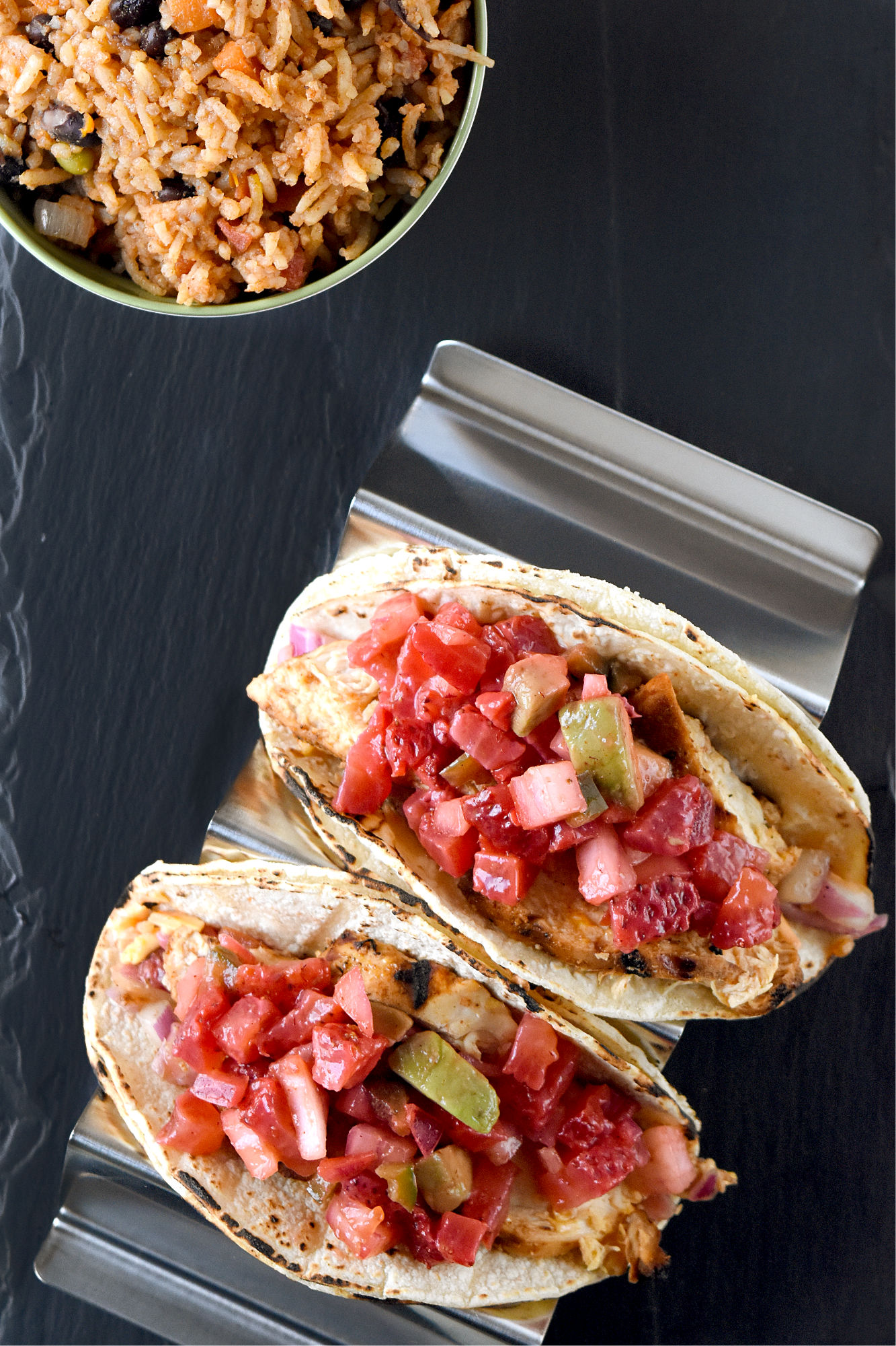Grilled Chicken Tacos with Strawberry Salsa have a sweet and spicy kick you will love. The strawberries replace the tomatoes in the salsa and fits perfect with the onions, jalapeno, and creamy avocado. #FarmersMarketWeek