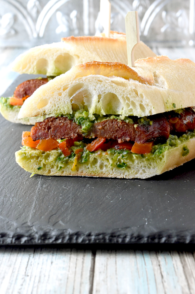 Grilled Choripán with Chimichurri is made with chorizo and delicious bread. The chimicurri is spread onto the bread so it will soak up all that delicious flavor. #FarmersMarketWeek