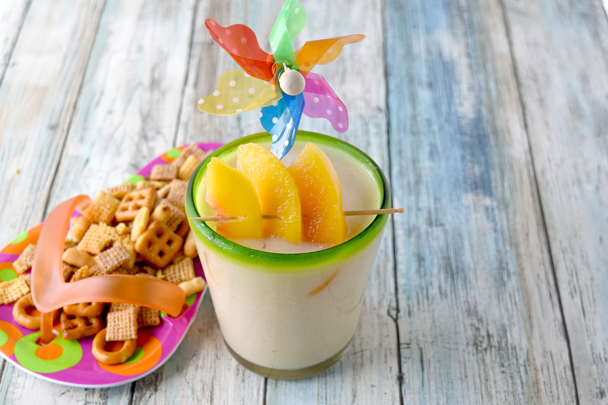 Peachy Colada has simple ingredients and tastes perfectly delicious. Made with frozen peaches, 2 types of rum, and crema of coconut, it's a refreshing summer colada you'll enjoy. #OurFamilyTable