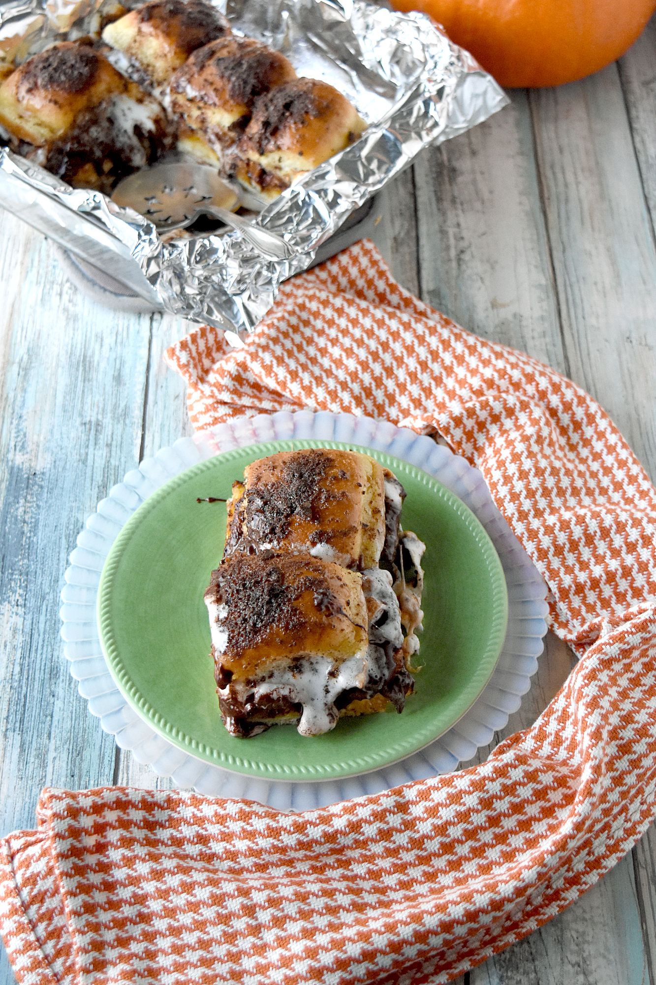 Pumpkin S'Mores Sliders are easy to make, are messy to eat, and taste perfectly delicious. The combination of the spiced pumpkin, chocolate, pecans, and caramel sauce are perfect with the sweet Hawaiian rolls. #PumpkinWeek