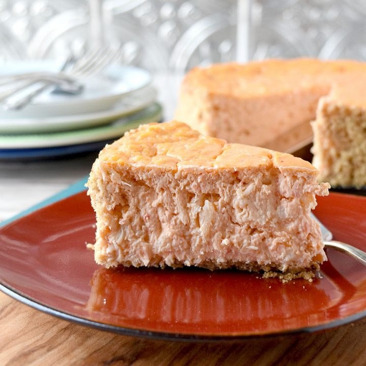 Roasted Red Pepper and Crab Savory Cheesecake has few ingredients, but still delight your family and guests with it's flavor. A savory cheesecake is perfect for an appetizer or a light meal with a salad. #FallFlavors