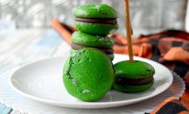 Poisoned Apple Macaron have freeze dried apples in the shells and apple simple syrup in the chocolate filling. Don't let the color fool you! They are perfectly delicious and totally not poisoned! #HalloweenTreatsWeek
